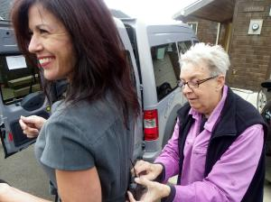 Jane hooks up Kelly´s mic before an afternoon of filming in Netarts. (Photo by Rocky)